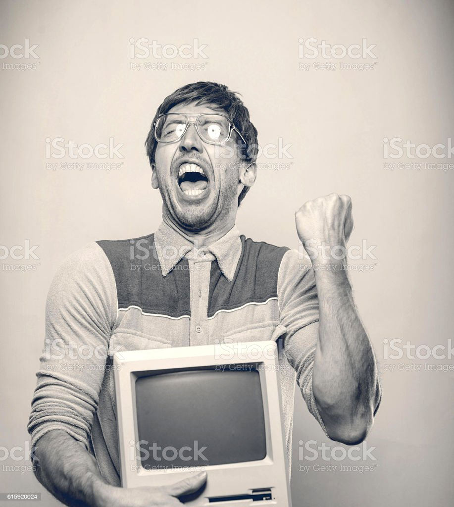 Excited 80's retro excited computer man stock photo