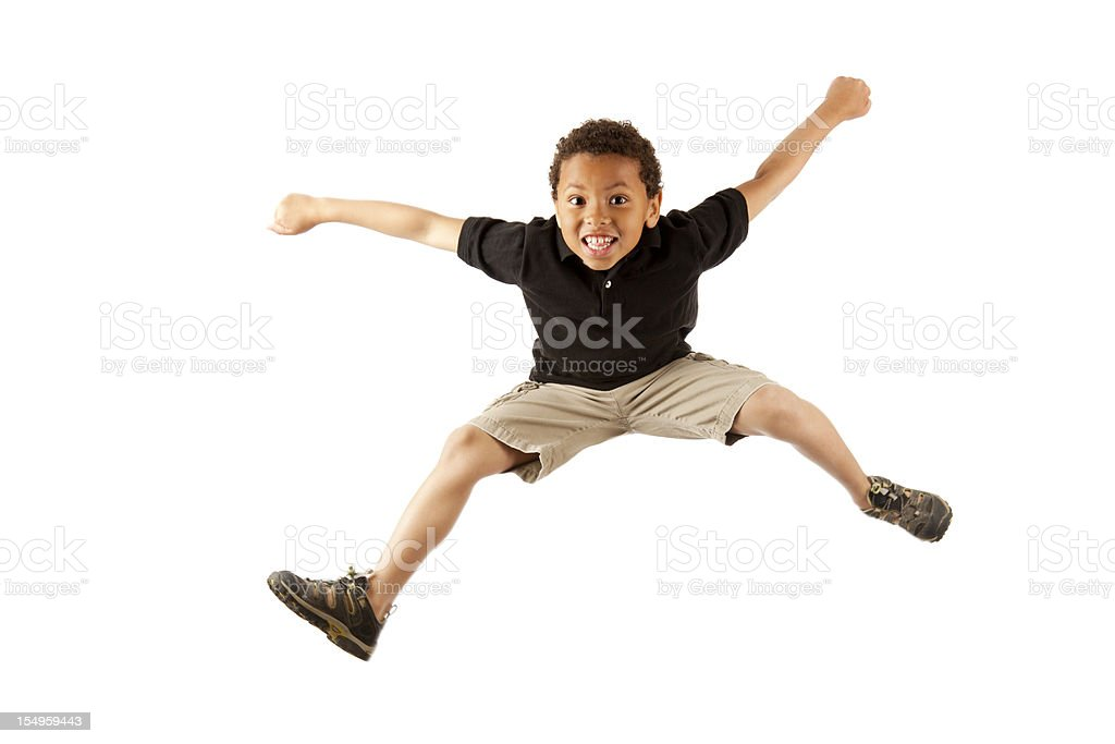 Excited 8-year old mixed race boy jumping on white stock photo