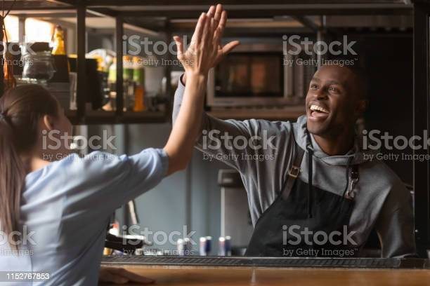 Excited african american barista giving high five with woman at work picture id1152767853?b=1&k=6&m=1152767853&s=612x612&h=wnmty4 gvcinrh2aoe9l2cewpkfyeva9ebgqpr5etjs=
