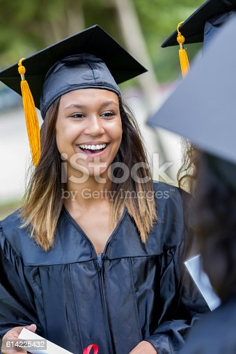istock Excited African American college grad laughs with friends 614225432