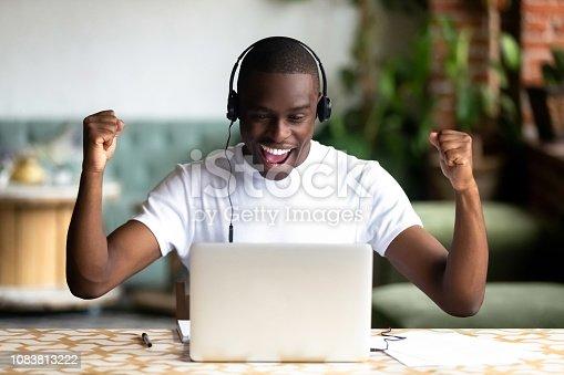 istock Excited African American man in headphones celebrating success 1083813222