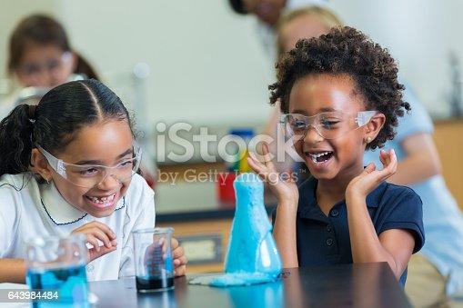 istock Excited African American schoolgirls enjoy science experiment 643984484