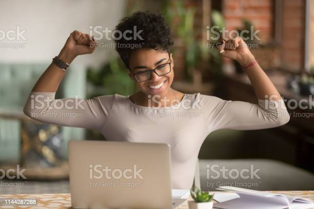 Excited african woman feeling winner rejoicing online win on laptop picture id1144287268?b=1&k=6&m=1144287268&s=612x612&h=kti1ul2j frzhapiqsmcke8rhudkrnme7fhznljcwe4=