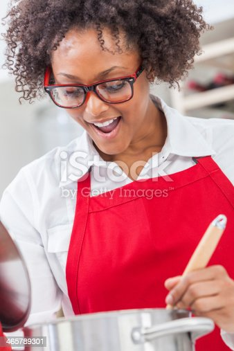 istock Excited African-American woman cooking in the kitchen 465789301
