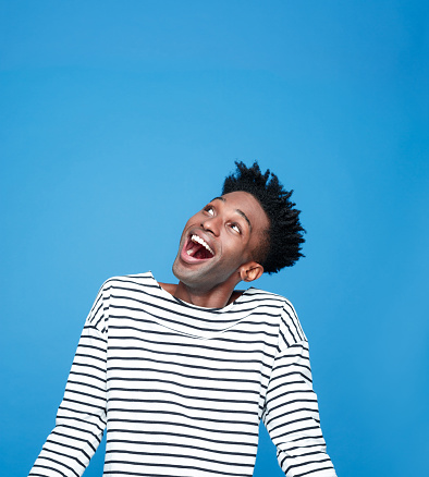 Excited Afro American Guy Stock Photo - Download Image Now
