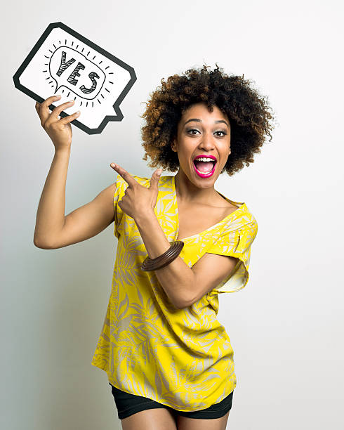 Excited Afro American Woman with speech bubble stock photo
