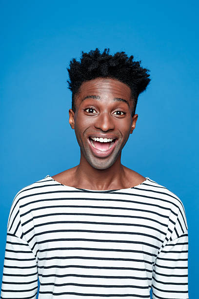 Excited afro american young man stock photo