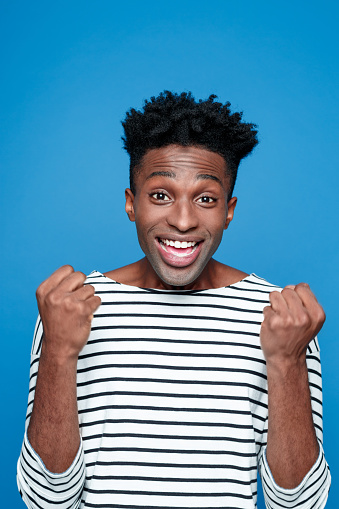 Excited Afro American Young Man Stock Photo - Download Image Now