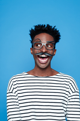 Excited Afro American Young Man Wearing Funny Glasses Stock Photo - Download Image Now
