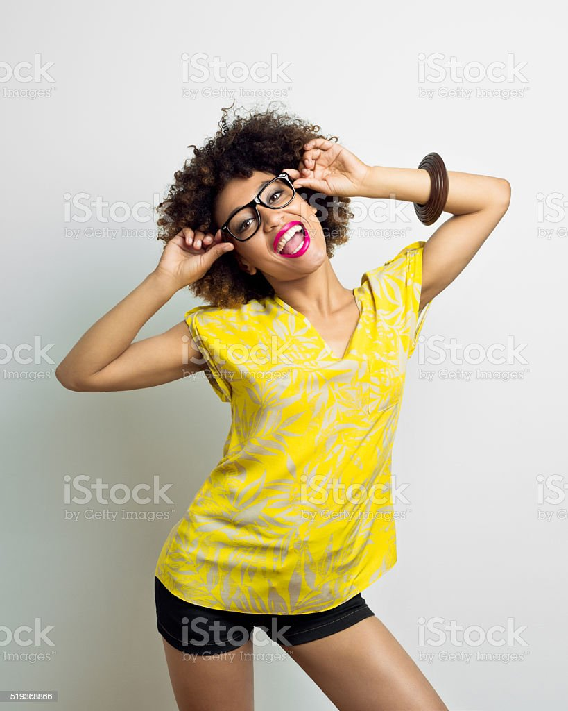 Excited afro american young woman wearing nerd glasses stock photo