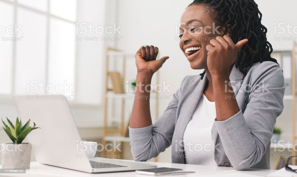 Excited Afro Businesswoman Celebrating Success At Work Business Success. African American Businesswoman Celebrating Victory At Work. Free Space Adult Stock Photo