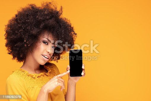 1159261513 istock photo Excited afro girl with mobile phone. 1159262079