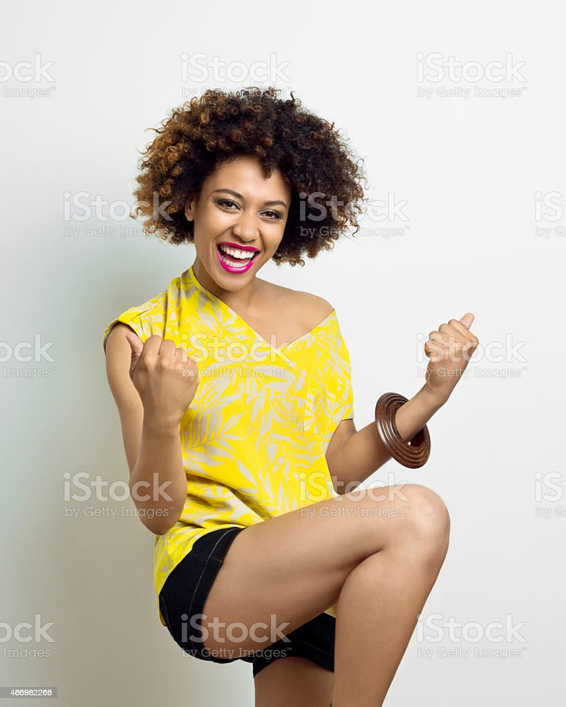 Excited Afro Young Woman stock photo