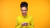 Excited Afro-American lady smiling on camera phone hand, social network message