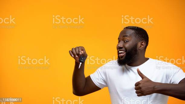 Excited afroamerican man holding car key and showing thumbs up picture id1152599011?b=1&k=6&m=1152599011&s=612x612&h=tmp2izb lch2zyctqswsai7cydlj3d9tzuvpwzd74ks=