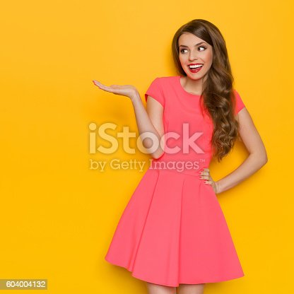 istock Excited And Happy Elegant Woman Presenting 604004132