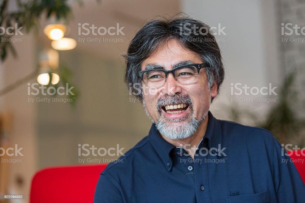 Excited and Happy Senior Japanese Man Relaxing at Home ストックフォト