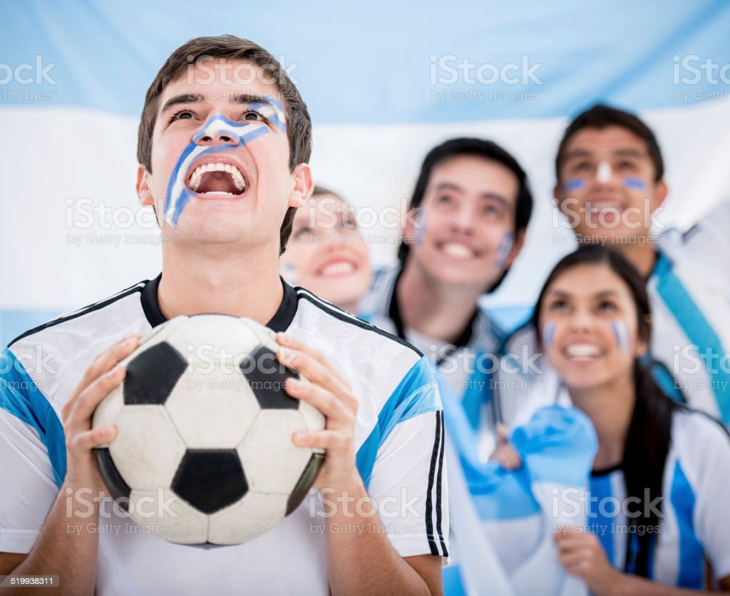 Excited Argentinean football fans stock photo