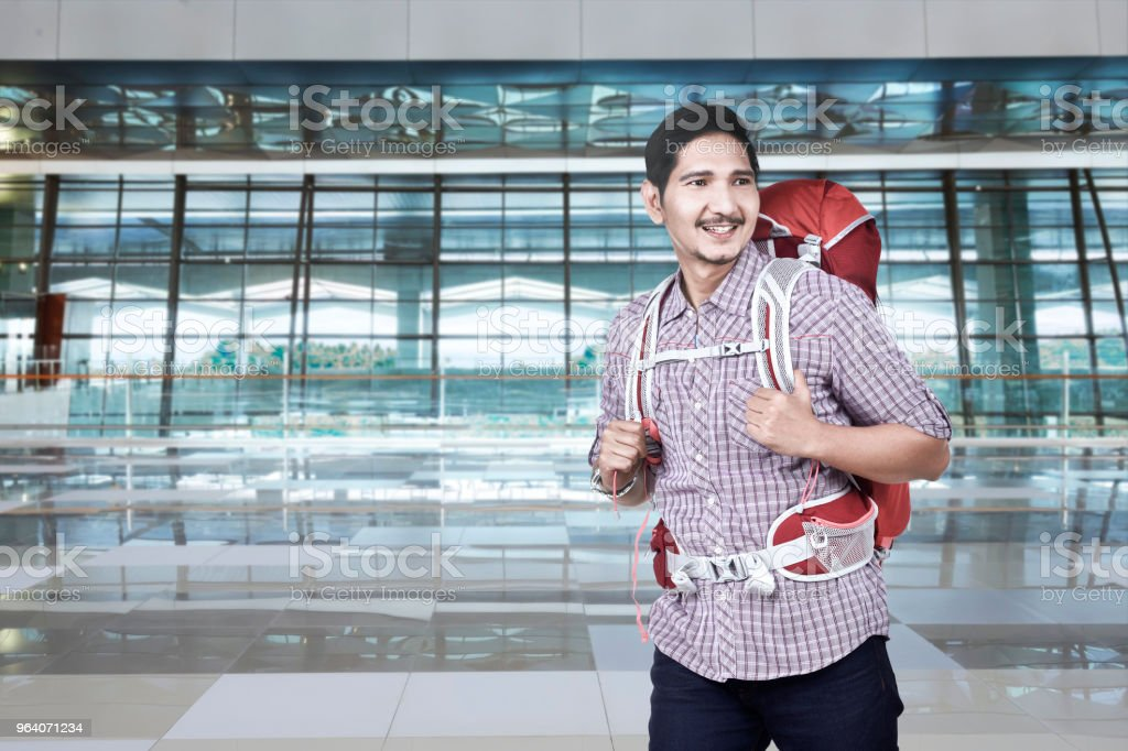 Excited asian backpacker going traveling - Royalty-free Adult Stock Photo