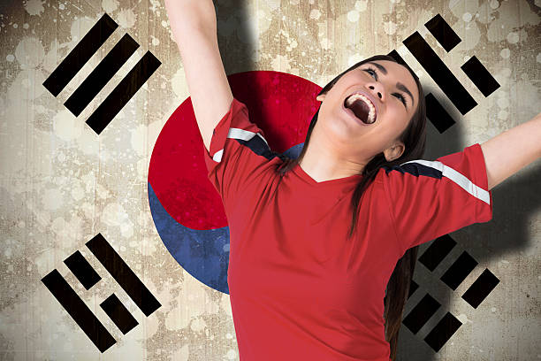Excited asian football fan cheering Composite image of excited asian football fan cheering against south korea flag sopaatervinning stock pictures, royalty-free photos & images
