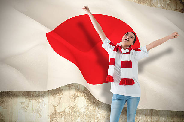 Excited asian football fan cheering Composite image of excited asian football fan cheering against japan flag sopaatervinning stock pictures, royalty-free photos & images