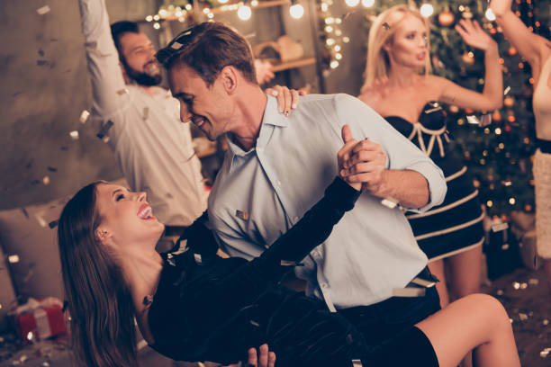 excited attractive charming beautiful cheerful well-dressed couple, husband holds, bends elegant wife, latin dance, ladies and handsome gentlemen at home festive, chill out, glitter falling down - tango taniec zdjęcia i obrazy z banku zdjęć