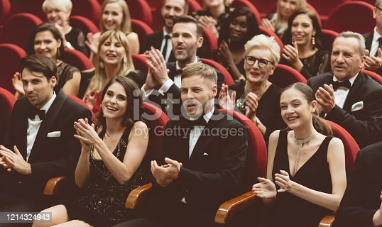 483876497 istock photo Excited audience clapping in opera house 1214324943