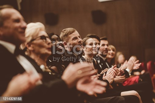483876497 istock photo Excited audience clapping in the theater 1214326153