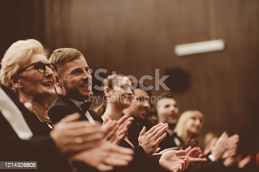 483876497 istock photo Excited audience clapping in the theater 1214326805