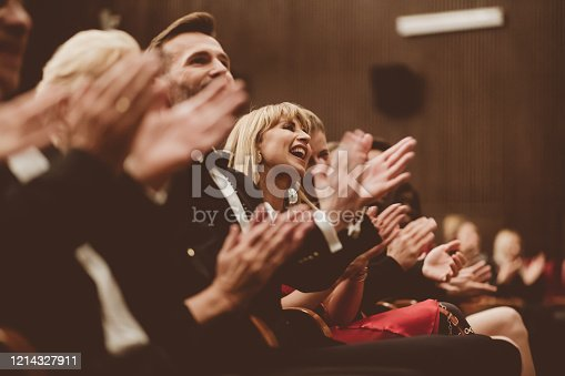 483876497 istock photo Excited audience clapping in the theater 1214327911