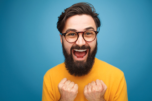 istock Excited bearded man in glasses 906201048