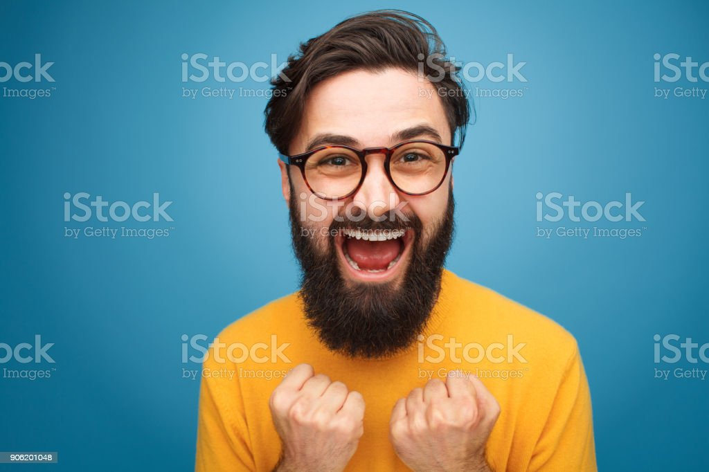 Excited bearded man in glasses stock photo
