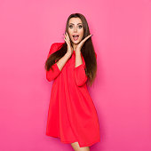 ... Chin  Excited Beautiful Woman In Red Mini Dress Is Holding Head In Hands  ... 5eccc1a6d