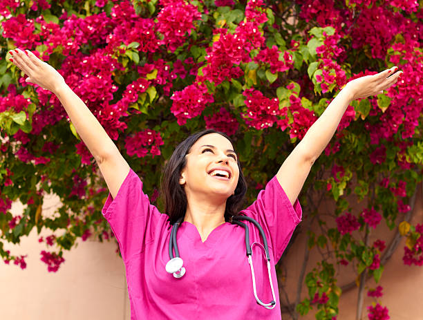 Excited Beautiful Young Female Nurse stock photo