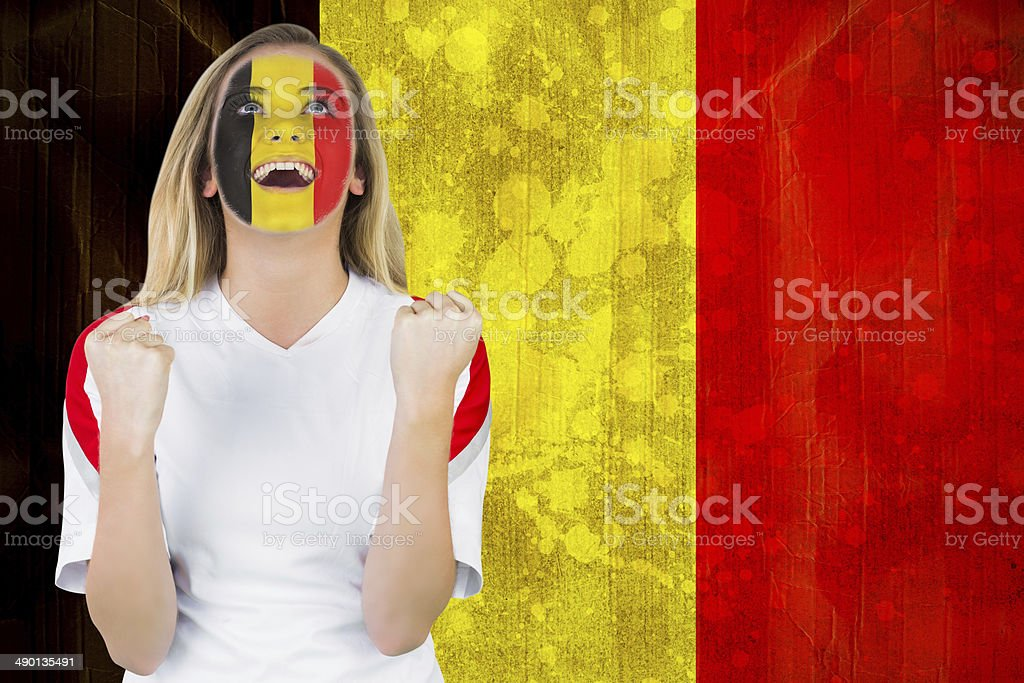 Excited belgium fan in face paint cheering stock photo