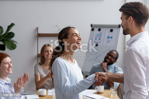 924519152 istock photo Excited biracial employee got promoted feels happy handshaking with boss 1091527120