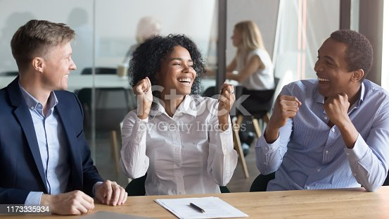 istock Excited black couple feel euphoric buying first house together 1173335934