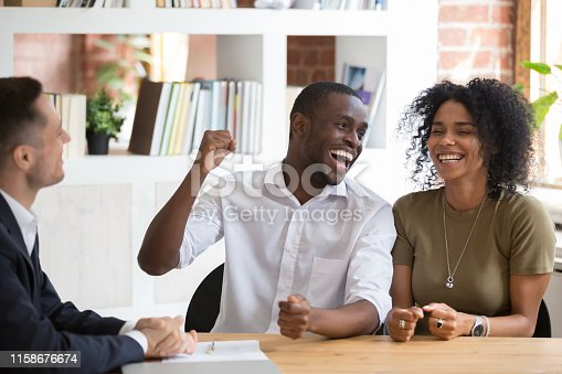 istock Excited black couple feel euphoric closing deal with realtor 1158676674