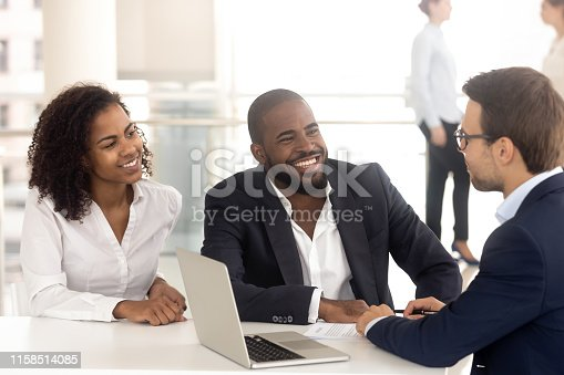 963814372istockphoto Excited black couple speak with realtor buying property together 1158514085