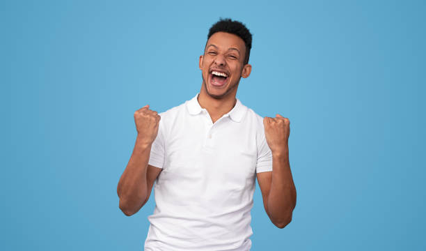 Excited black male celebrating victory stock photo