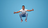istock Excited black student jumping and gesturing thumbs up 1161476444