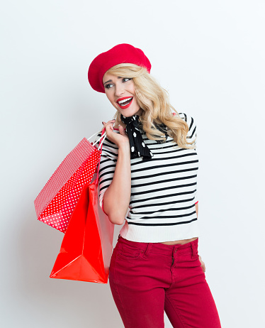 Excited Blonde French Woman Wearing Red Beret Holding Shopping Bags Stock Photo - Download Image Now