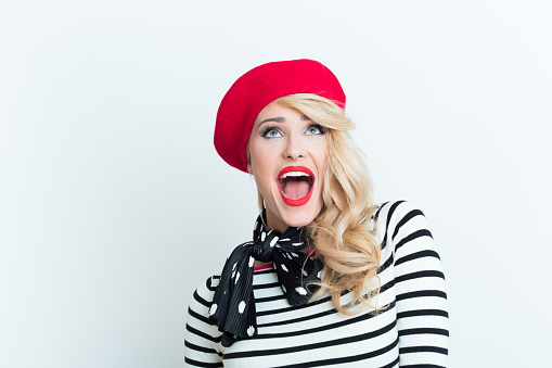 Excited Blonde French Woman Wearing Red Beret Stock Photo - Download Image Now