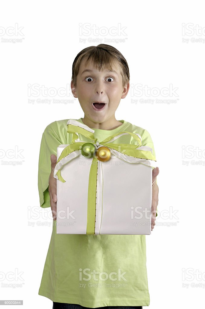 Excited boy holding a wrapped present royalty-free stock photo