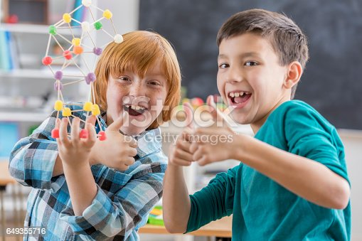 648947070 istock photo Excited boys complete fun engineering project at school 649355716