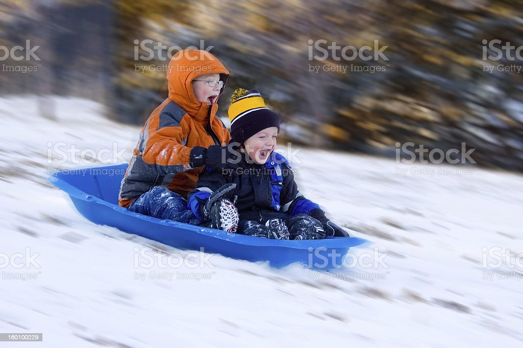Excited Boys on Sled Ride stock photo