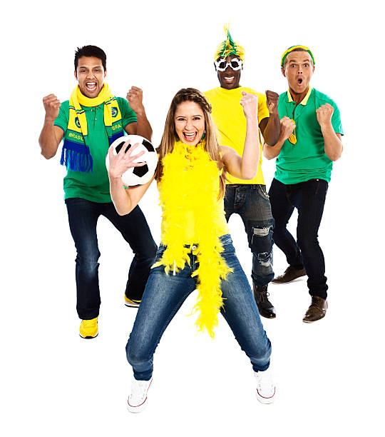 Excited Brazilian soccer fans cheer on their team Four excited and enthusiastic soccer fans wearing Brazilian colors and carrying a soccer ball, cheer their team! Isolated on white. fan club stock pictures, royalty-free photos & images