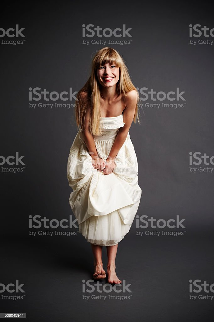 Excited bride looking at camera, portrait stock photo