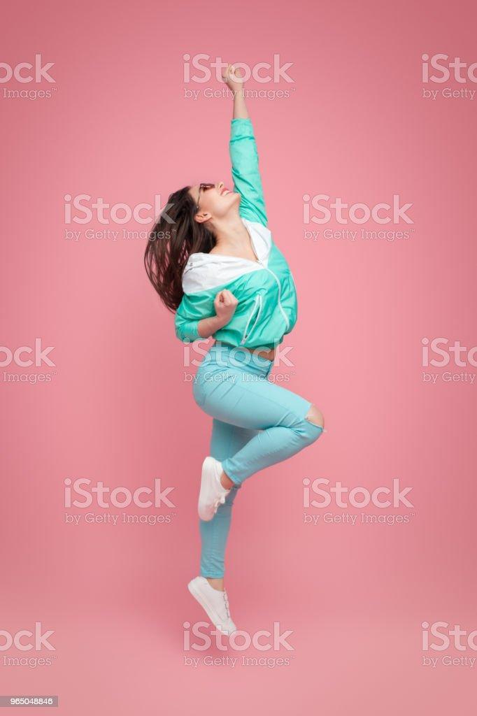 Excited bright hipster girl on pink zbiór zdjęć royalty-free