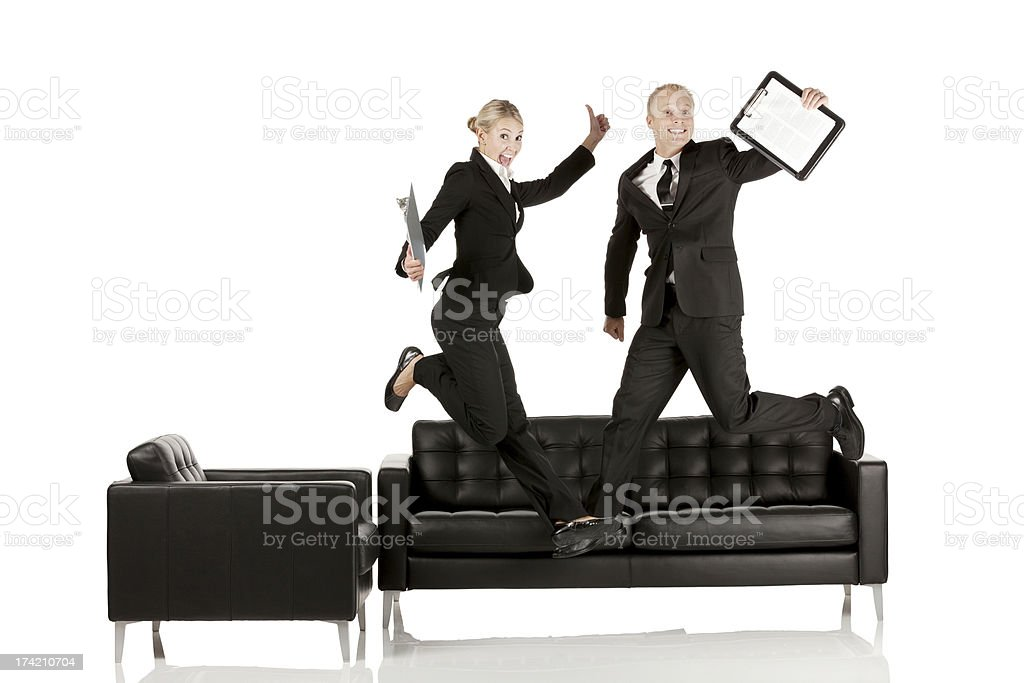 Excited business colleagues jumping royalty-free stock photo
